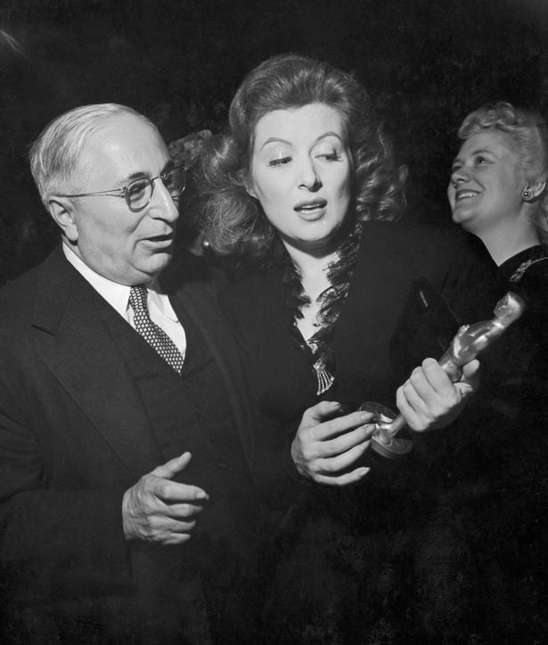 Film producer Louis B Mayer 1884 1957 admires the Oscar statue won by actress Greer Garson