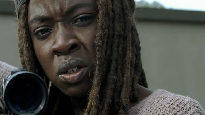 michonne looks like shes a bit farther away in a sniper position however it looks like shes worried over something w700